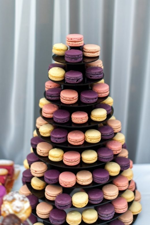 Sweet pyramid of the colorful french macaroons for the birthday, event or wedding