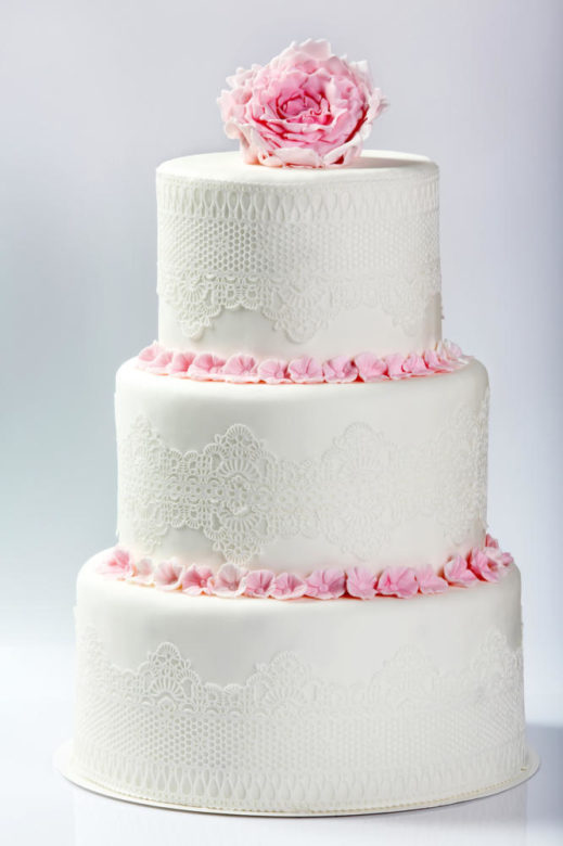 White wedding cake with pink rose