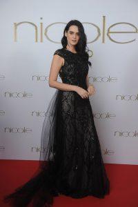 Nicole fashion group, Catherine Poulain